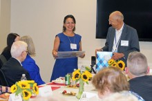 Kirsten Grunberg presenting artwork to Ambassador Abbadi